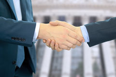 Close-up image of a firm handshake between two colleagues in office Stock Photos