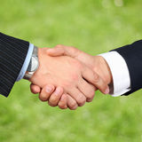 Close-up image of a firm handshake  between two colleagues outsi Stock Photography
