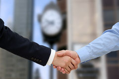 Close-up image of a firm handshake  between two colleagues in of Royalty Free Stock Photography