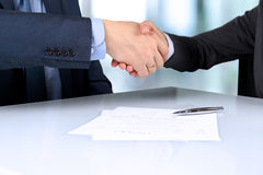 Close-up image of a firm handshake between two colleagues after Royalty Free Stock Photo