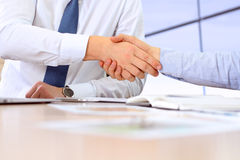Close-up image of a firm handshake between two colleagues after signing a contract Stock Image