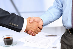 Close-up image of a firm handshake between two colleagues u Royalty Free Stock Photo