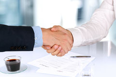 Close-up image of a firm handshake  between two colleagues under Royalty Free Stock Image
