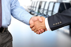 The Close-up image of a firm handshake between two colleagues on white background Stock Photo