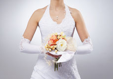 Close-up image of flowers held in bride's hands Stock Photos