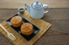 Close up image of food dessert decorations Chinese Moon Festival background. Concept.Accessories cake & tea cup and bamboo on modern rustic wooden plank.Free stock images