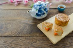 Close up image of food dessert decorations Chinese Moon Festival background concept. Food & drink the cake with tea cup and pink blossom on modern rustic wooden stock photos