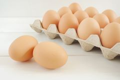 Fresh chicken eggs on white wooden table. royalty free stock images