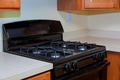 Close up image of the gas stove. Steal standing on kitchen gas stove Stock Photos