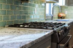 Close up image of the gas stove. Steal standing on kitchen gas stove Royalty Free Stock Photos