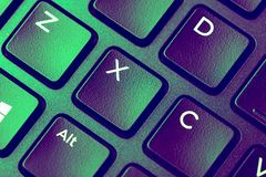 Close up image of Green purple keyboard with x key royalty free stock image