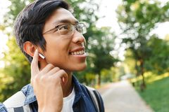 Close up image of Happy asian male student in eyeglasses royalty free stock photo