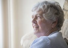Happy senior woman indoors smiling Royalty Free Stock Photography