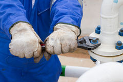 Close-up image of human hand fixing and stop leak flange by wrench Stock Photos