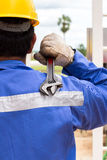 Close-up image of human hand holding wrench Stock Photo