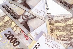 A close up image of Indonesian 2000 rupiah notes. Indonesian 2000 rupiah bank notes shot close up Stock Photo