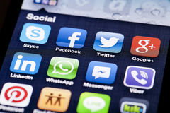 Close-up image of an iPhone screen with icons of royalty free stock image