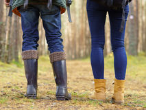 Close-up image of legs of a couple walking in forest. Camp, tour royalty free stock images