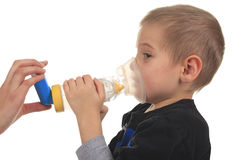 Close-up image little boy using inhaler for asthma Stock Image