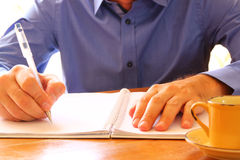 Close up image of male hands writing at notebook. selective focus. Close up image of male hands writing at notebook. selective focus Royalty Free Stock Images