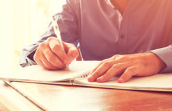 Close up image of male hands writing at notebook. selective focus. Close up image of male hands writing at notebook. selective focus Royalty Free Stock Photography