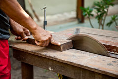Man working on a saw. Royalty Free Stock Photo