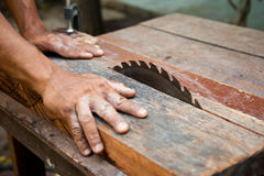 Man working on a saw. Royalty Free Stock Photography