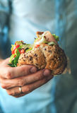 Close up image man hand with big hamburger Stock Photo