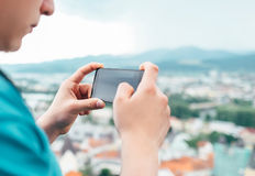 Close up image man hands with modern phone taking picture of cit Stock Photo