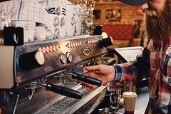 Close up image of a man making coffee. Close up image of a man making coffee in a professional coffee machine Royalty Free Stock Photos