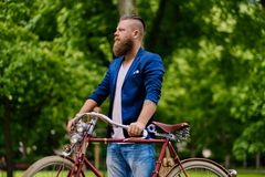 Image of a man on a retro bicycle. Close up image of a man on a retro bicycle stock image