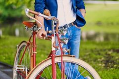 Image of a man on a retro bicycle. Close up image of a man on a retro bicycle stock photos