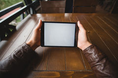 Close up image of man using a mobile digital tablet Royalty Free Stock Photo