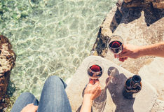 Close up image man and woman hands with goblet of wine at the se Royalty Free Stock Photo