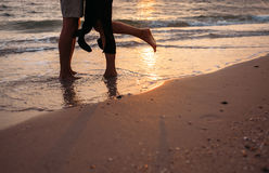 Close up image man and woman legs on surf sea line Royalty Free Stock Photos