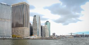 Close up image of Manhattan buildings lining the East River. Stock Photos