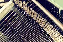 Close up image of metallic typewriter keys. vintage filtered. selective focus Royalty Free Stock Photography
