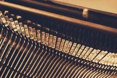 Close up image of metallic typewriter keys. vintage filtered. selective focus Stock Photos