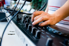 Close-up image of mixing console. And DJ`s hands during his job at party stock photo