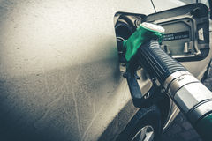 Close up image of modern car refueling on a petrol station. Copyspace Royalty Free Stock Image