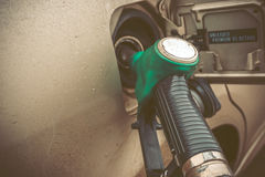 Close up image of modern car refueling on a petrol station. Toned  image with co Stock Photography