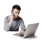 Close up image of multitasking business man using a laptop and mobile phone royalty free stock photos