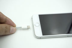 Close up image of the new apple iphone 6s with the charging cabl Stock Photography