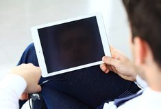 Close-up image of an office worker using a touchpad to analyze Stock Photos