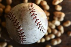 Old Leather Baseball and Roasted Peanuts royalty free stock photo