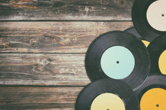 Close up image of old records over wooden table , image is retro filtered . Close up image of old records over wooden table , image is retro filtered royalty free stock image