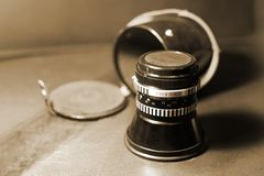 Close up image of old vintage dusty lens with box on blurred background, selective focus. royalty free stock image