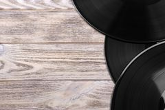 Close up image of old vinyl records over wooden background with copy space.  Royalty Free Stock Photography