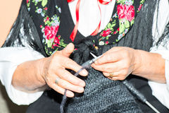 Close-up image of an old woman with knitting needles and wool Royalty Free Stock Photos