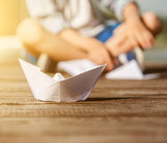 Close up image paper ship on the wooden pier Royalty Free Stock Image